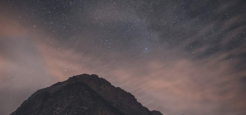 A mountain on a starry night.