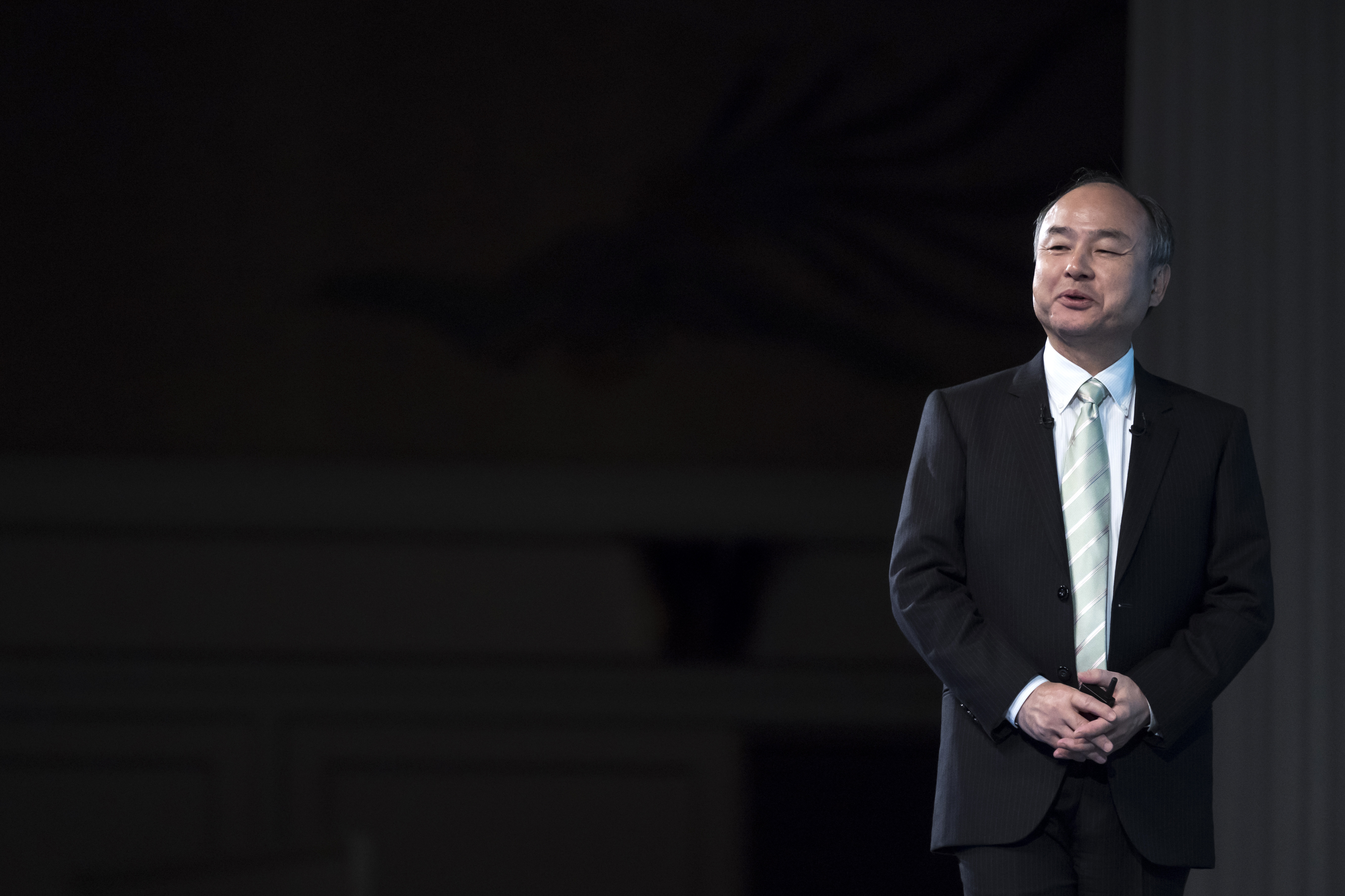 TOKYO, JAPAN - FEBRUARY 12: SoftBank Group Corp. TOKYO, JAPAN - FEBRUARY 12: SoftBank Group Corp. Chairman and Chief Executive Officer Masayoshi Son speaks during a press conference on February 12, 2020 in Tokyo, Japan. SoftBank reported its third-quarter earnings results today following the approval of a merger between T-Mobile US Inc. and SoftBank's U.S. telecom unit Sprint Corp. from a federal judge. (Photo by Tomohiro Ohsumi/Getty Images)