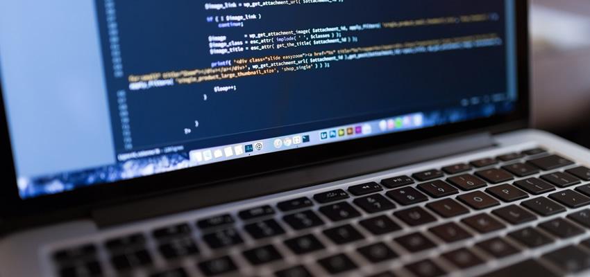 Hire A Web Designer - Coding laptop