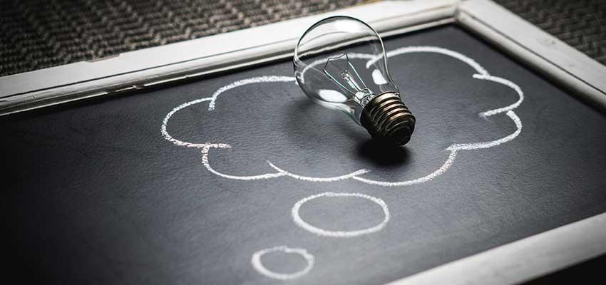 Lightbulb on a chalkboard